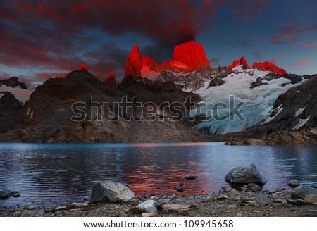 Laguna de Los Tres and mount Fitz Roy, Dramatical sunrise, Patagonia, Argentina - stock photo