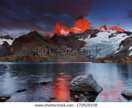 Laguna de Los Tres and mount Fitz Roy, Dramatical sunrise, Patagonia, Argentina - stock photo