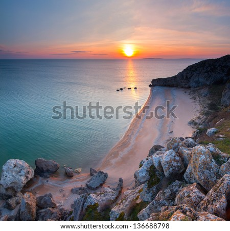 Laguna in the ocean at sunset - stock photo