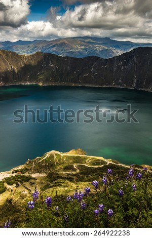 Laguna Quilotoa, Ecuador. It is a 3 km wide water-filled caldera and the most western volcano in the Ecuadorian Andes. Amazing views, turquoise water. Quilotoa is a tourist site of growing popularity. - stock photo