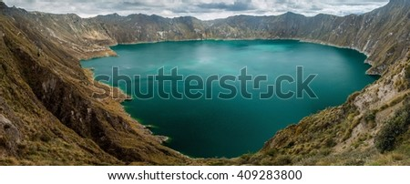 Laguna Quilotoa - volcanic crater lake in Ecuador - stock photo