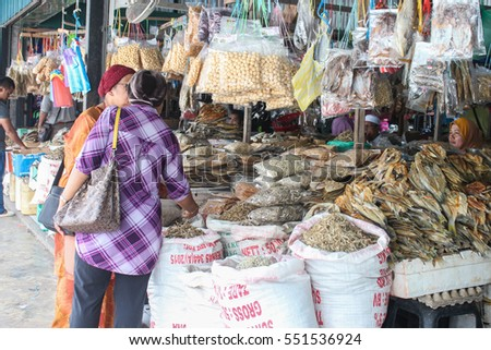 LAHAD DATU, SABAH MALAYSIA- JAN 07, 2016: People buying dried anchovies at the local market