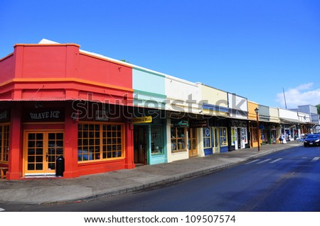 LAHAINA, HI - JULY 14: Old Lahaina storefronts on the Lahaina, Maui waterfront on July 14, 2012. Lahaina was once capital of Hawaii and home to the whaling industry. Now it is a pretty tourist town. - stock photo