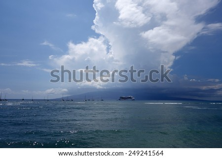 LAHAINA, HI - SEPTEMBER 30: Princess Cruise Ship docked along with other boats off coast of Maui with Lanai in the distance a passengers take small boat to shore on September 30, 2014.  - stock photo