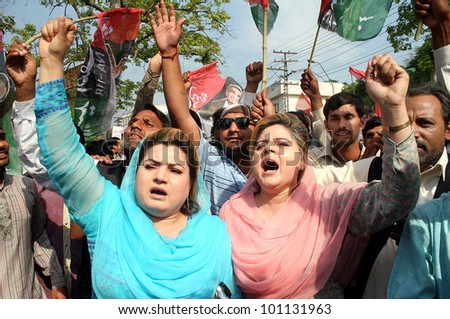 LAHORE, PAKISTAN - APR 27: Supporters of Peoples Party (PPP) shout slogans during demonstration against conviction of Prime Minister Syed Yousuf Raza Gilani, on April 27, 2012 in Lahore.