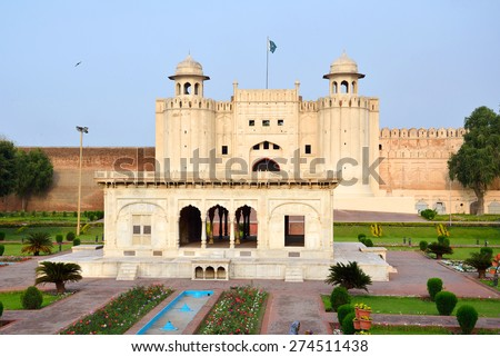 LAHORE, PAKISTAN  APRIL 3 2015: Hazuri Bagh is a square that is situated between Lahore Fort and Badshahi Mosque.There is a marble baradari in the middle of it.  - stock photo