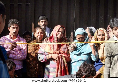 LAHORE, PAKISTAN - FEB 06: Women mourn at the site of building collapse incident in Lahore on Monday, February 06, 2012.
