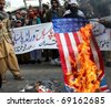 LAHORE, PAKISTAN - JAN 16: Activists of World Pasban Khatam-e-Nabouat burn US flag and protest against amendment in Blasphemy Law on January 16, 2011 in Lahore, Pakistan. - stock photo