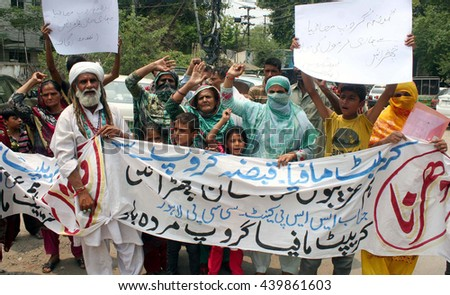 LAHORE, PAKISTAN - JUN 20: Residents of Punjab Society Ghazi road chant slogans against high handedness of land grabber during protest demonstration on June 20, 2016 in Lahore.