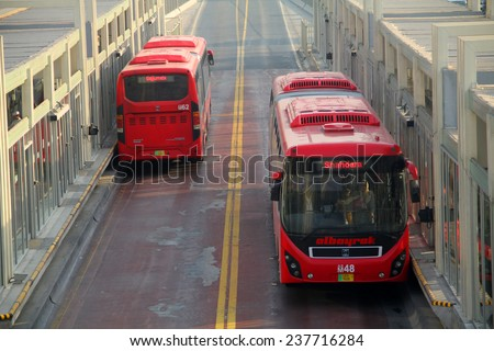LAHORE, PAKISTAN - NOVEMBER 30: Lahore Metro Bus Leaving Passengers Terminal. Lahore Metro has a 27 KM Long Route and joins two ends of Lahore City on November 30, 2014 - stock photo