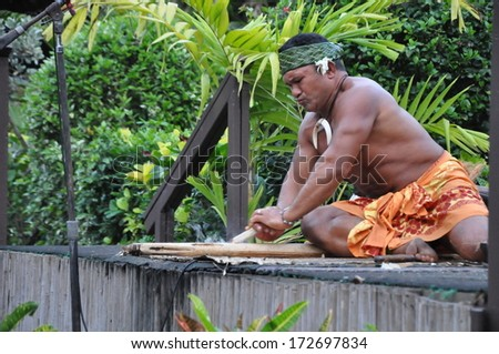 LAIE, HAWAII - DEC 26: An interpretive artist lecturing on traditional Samoan fire-making techniques at the Polynesian Cultural Center on December 26, 2012 in Laie, Oahu in Hawaii. - stock photo