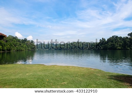 Lake and forest under blue sky at MacRitchie Reservoir, Singapore - stock photo