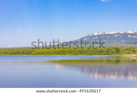 Lake and mountain in sunny weather, Urals, Russia