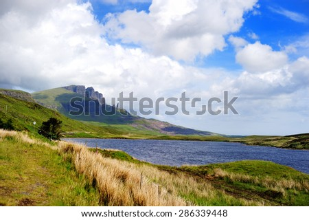 Lake and Mountains in Isle of Skye island under a cloudy sky. Landscape in Highlands of Scotland, Uk, Europe.