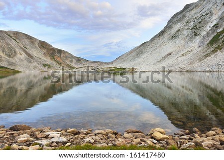 lake and reflection at Medicine Bow Mountains of Wyoming during summer - stock photo