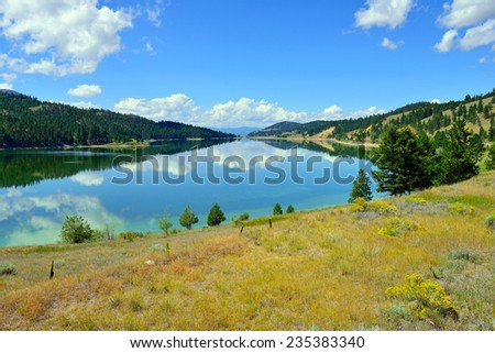 lake and reflection of clouds in Montana near Glacier National Park in Summer - stock photo