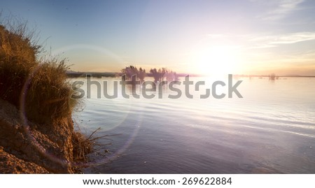 Lake and sunset.Romantic shore landscape - stock photo