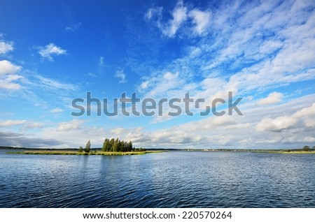 Lake and the dramatic cloudscape after the rain - stock photo