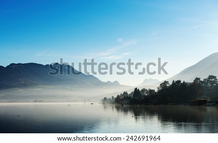 Lake Annecy in France in autumn at sunset - stock photo