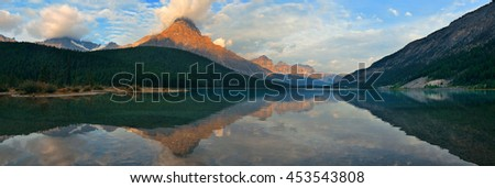 Lake at sunrise with cloud and mountain reflections in Banff National Park