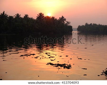 Lake at sunset in the backwaters of Kerala, India.