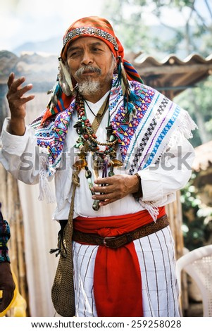 LAKE ATITLAN, GUATEMALA - SEPTEMBER 20: A candid portrait of a Mayan shaman during his performance of a traditional fire ceremony, Guatemala on September 20, 2009