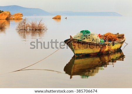 Lake Bafa near Bodrum, Mugla. The water and the fishing boats in a very tranquil scene. The region is the culture and nature rich national park and  important for tourism and tourists   - stock photo