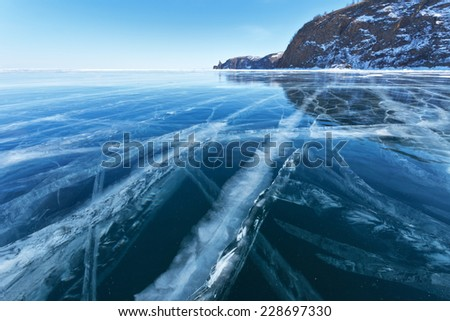 Lake Baikal in winter. Beautiful blue sleek ice