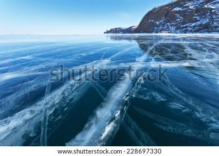Lake Baikal in winter. Beautiful blue sleek ice - stock photo