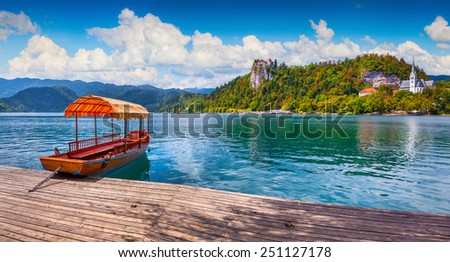 Lake Bled (Blejsko jezero) is a glacial lake in the Julian Alps in northwestern Slovenia, where it adjoins the town of Bled and is overlooked by Bled Castle. - stock photo