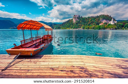 Lake Bled (Blejsko jezero) is a glacial lake in the Julian Alps in northwestern Slovenia, where it adjoins the town of Bled and is overlooked by Bled Castle. Instagram toning. - stock photo