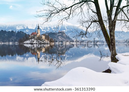 Lake Bled with St. Marys Church of the Assumption on the small island; Bled, Slovenia, Europe. - stock photo