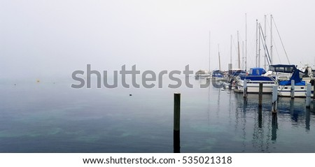 Lake Boats moored in a misty harbor