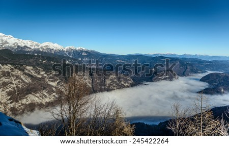 Lake Bohinj in fog from Vogel cable car top station, Slovenia  - stock photo