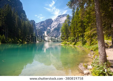 Lake Braies with a turist path in the Dolomite Mountains, Italy