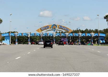 LAKE BUENA VISTA, FL - APRIL 18: Vehicles wait in line to enter the Magic Kingdom section of Walt Disney World on April 18, 2013. Walt Disney World is the worlds most visited theme park.