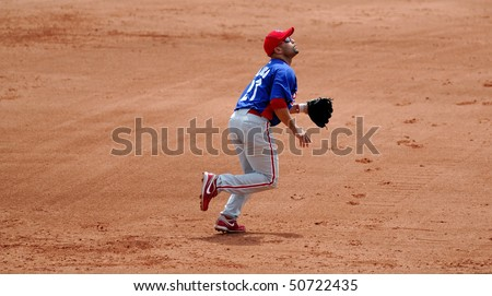 LAKE BUENA VISTA, FL - MARCH 24: Philadelphia Phillies third baseman Placido Polanco runs under a pop-up on the infield during the spring training game on March 24, 2010 in Lake Buena Vista, FL.