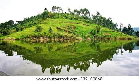 Lake Bunyonyi, at the borders of Uganda, Congo Democratic Republic and Rwanda. Lake Bunyonyi is popular with tourists. - stock photo