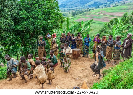 LAKE BUNYONYI, UGANDA - OCTOBER 21: Batwa pygmies dancing on October 21, 2012 in Lake Bunyonyi, Uganda. Pygmy people are ancient dwellers in the forests, they were known as The Keepers of the Forest.