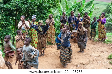 LAKE BUNYONYI, UGANDA - OCTOBER 21: Unidentified Batwa pygmies dancing on October 21, 2012 at Lake Bunyonyi, Uganda. Pygmy people are ancient dwellers in the forests, they were known as The Keepers of the Forest.
