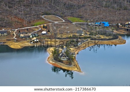 LAKE BURTON, GA, USA - JANUARY 19, 2012: An aerial view of a portion of houses and landscape that was destroyed by a tornado is being rebuilt. - stock photo