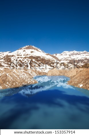 Lake Emosson reservoir of hydroelectric Dam near village of Chatelard, Swiss on the border with France - stock photo