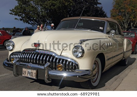 LAKE GENEVA, WI - SEPTEMBER 25: A retro car Buick Eight at the annual Geneva Lake Classic Car Rally on September 25, 2010 in Lake Geneva, WI - stock photo