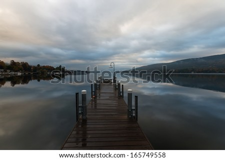 Lake George and the Adirondack Mountains at sunrise - stock photo