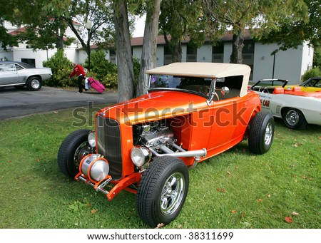 LAKE GEORGE, NY - SEPT 12: A '32 Ford style Convertible being shown off at the 21st Annual Adirondack Nationals on September 12, 2009 in Lake George, NY - stock photo