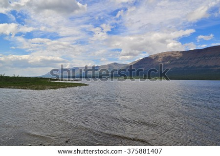 Lake Glubokoe on the Putorana plateau. Mountain lake on the Taimyr Peninsula in the summer.