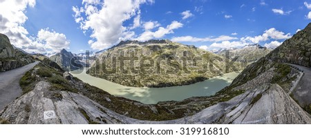 lake Grimselsee in the Swiss mountains - stock photo