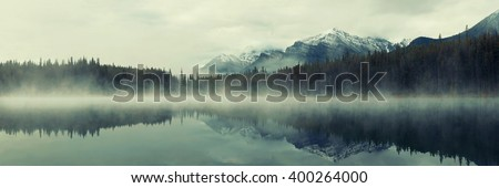 Lake Herbert panorama in a foggy morning with glaciers mountain and reflection in Banff National Park, Canada - stock photo