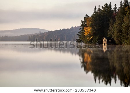 Lake in Autumn Algonquin Muskoka Ontario colors boat house