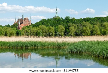 Lake in city park with skyline in background Zamosc, Poland. - stock photo